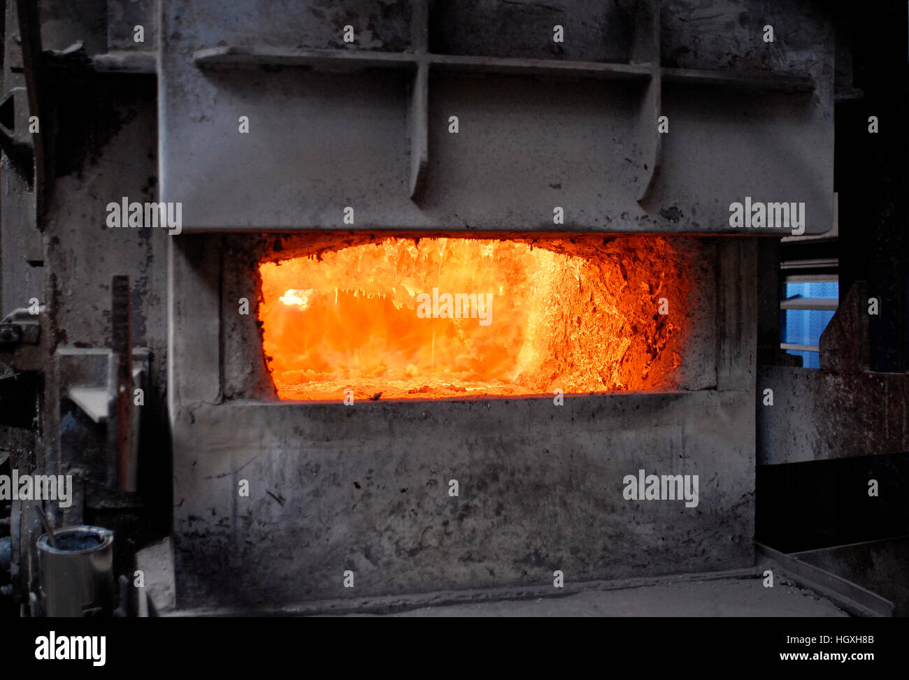 Looking into a melting furnace in a foundry for aluminum casting. - Stock Image