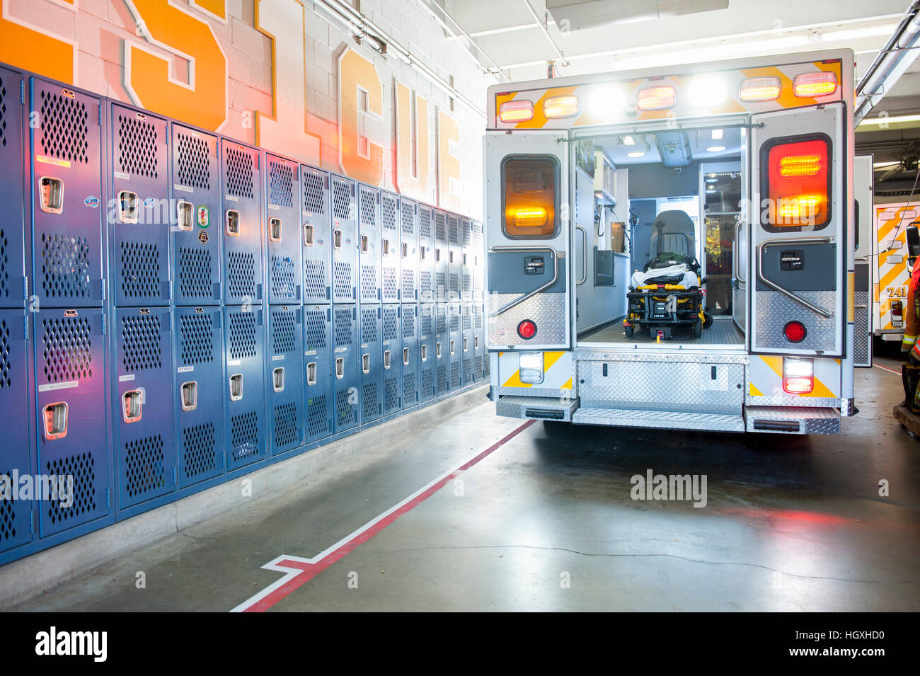 USA Maryland MD Ambulance parked inside the rescue station ready for an emergency response - Stock Image