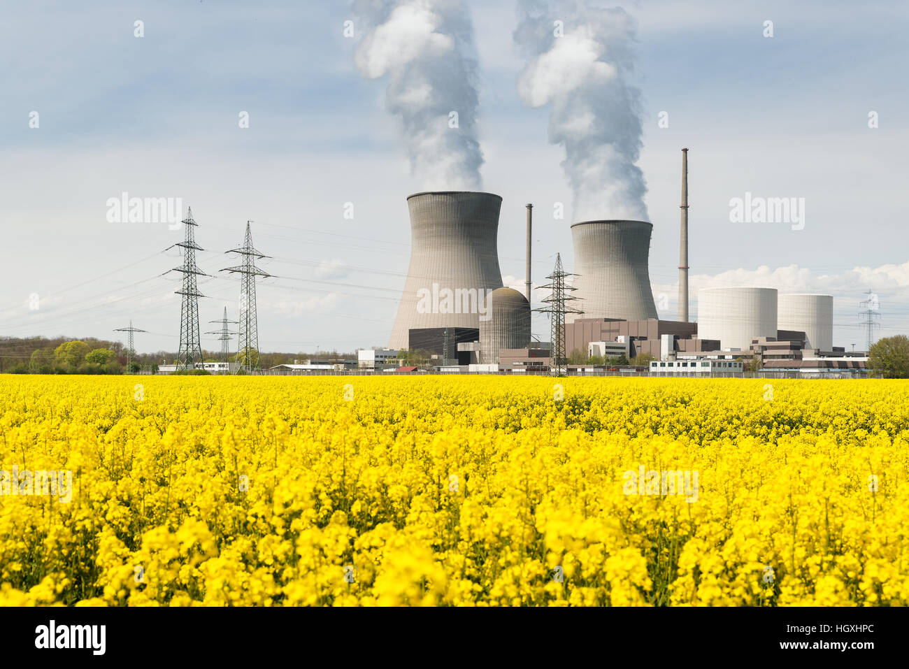 Nuclear power plant with yellow field and big blue clouds in Germany - Stock Image