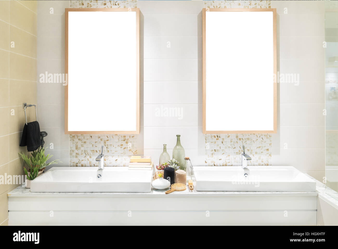 Interior of bathroom with washbasin faucet and black towel in hotel ...