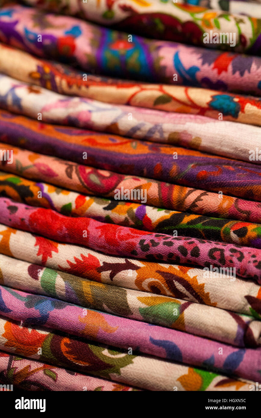 Image of wool and silk scarfs in a asian market - Stock Image