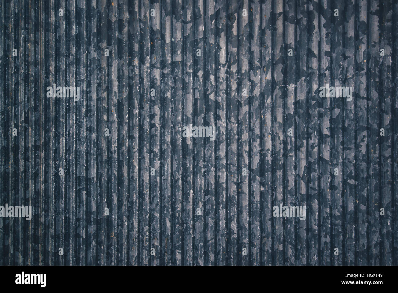Zinc galvanized metal plate texture as industrial background - Stock Image