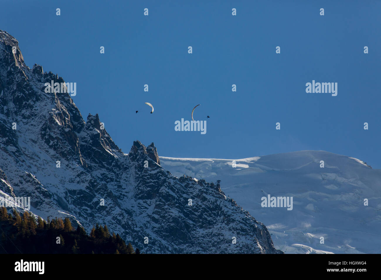 A parapenter flying in the Chamonix valley Stock Photo