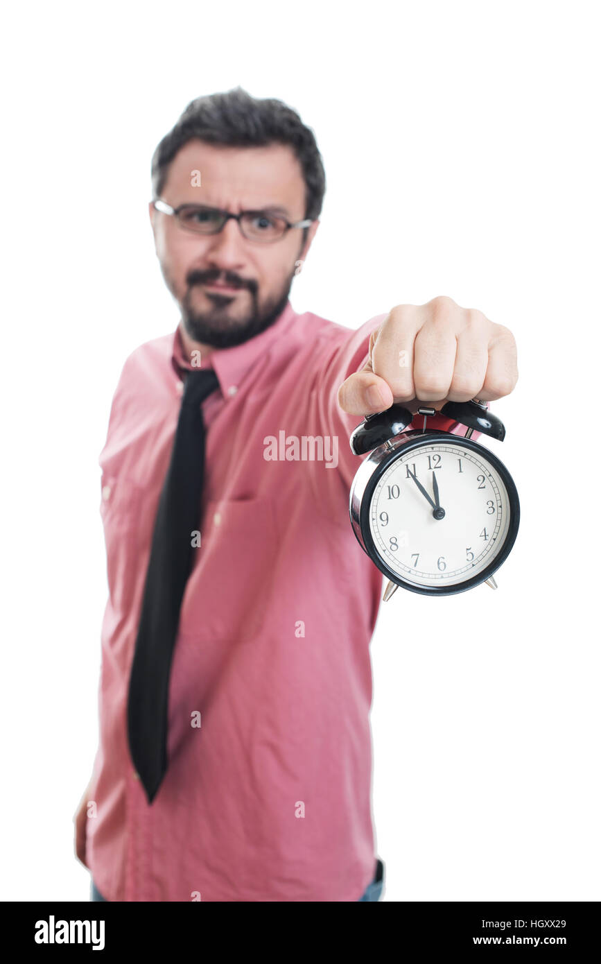 Young man showing an alarm clock Stock Photo