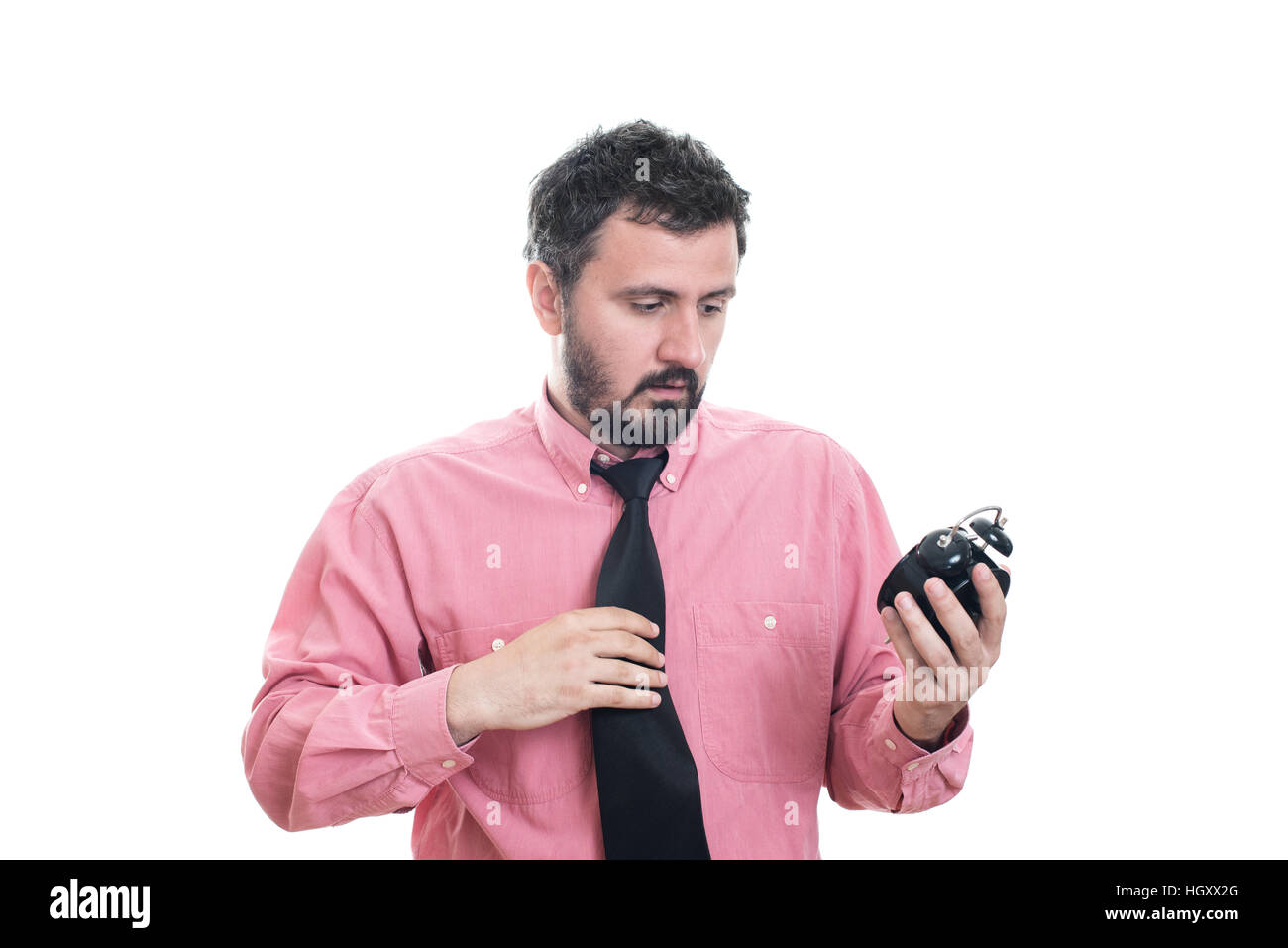 Angry young man holding alarm clock Stock Photo