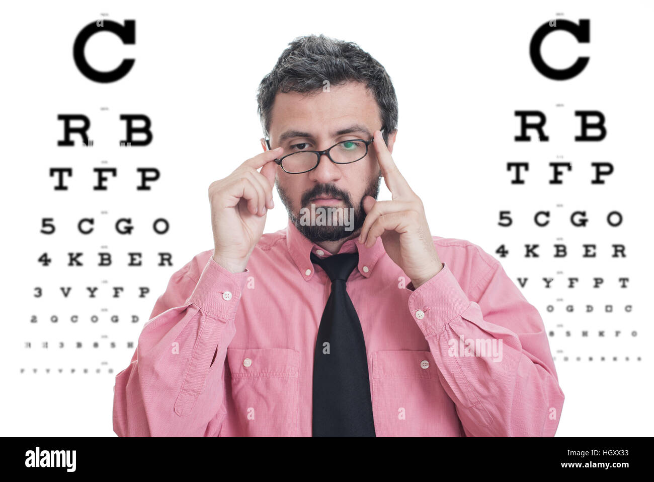 Man taking an eye exam and wearing glasses Stock Photo