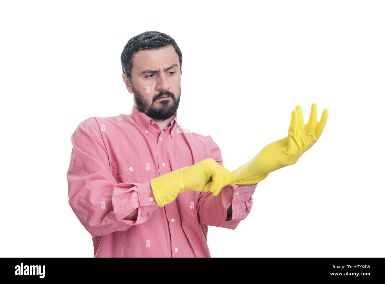 Cleaning man putting latex glove and prepare to clean house isolated on white background Stock Photo