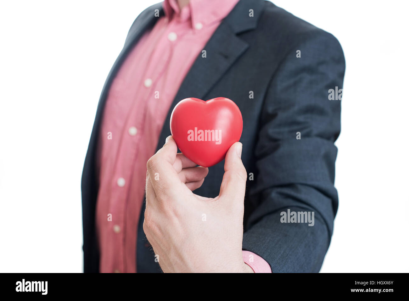 Man holding red heart in his hands Stock Photo