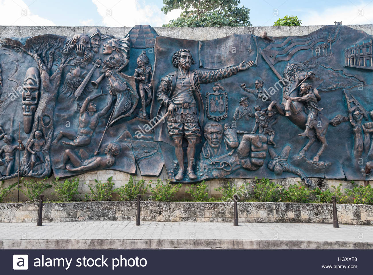 Details of the 'Origins' bas-relief mural on 'Parque de las Flores' in the city.  This 15 meter - Stock Image