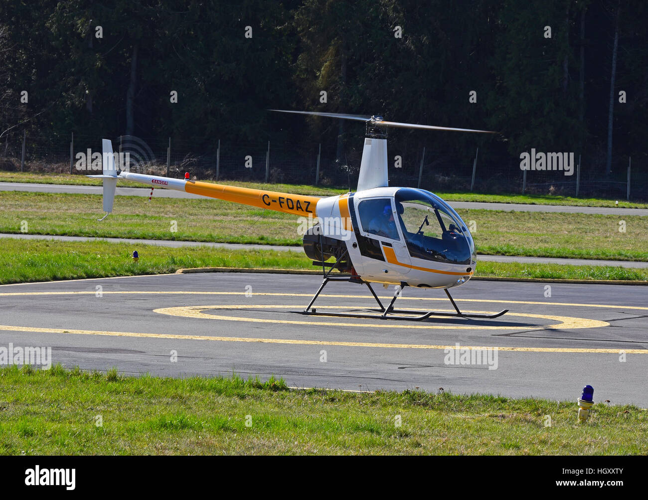 Robinson R22 (C-FDAZ) Light two seat helicopter at Qualicum airport on Vancouver island, BC. Canada.  SCO 11,598. - Stock Image