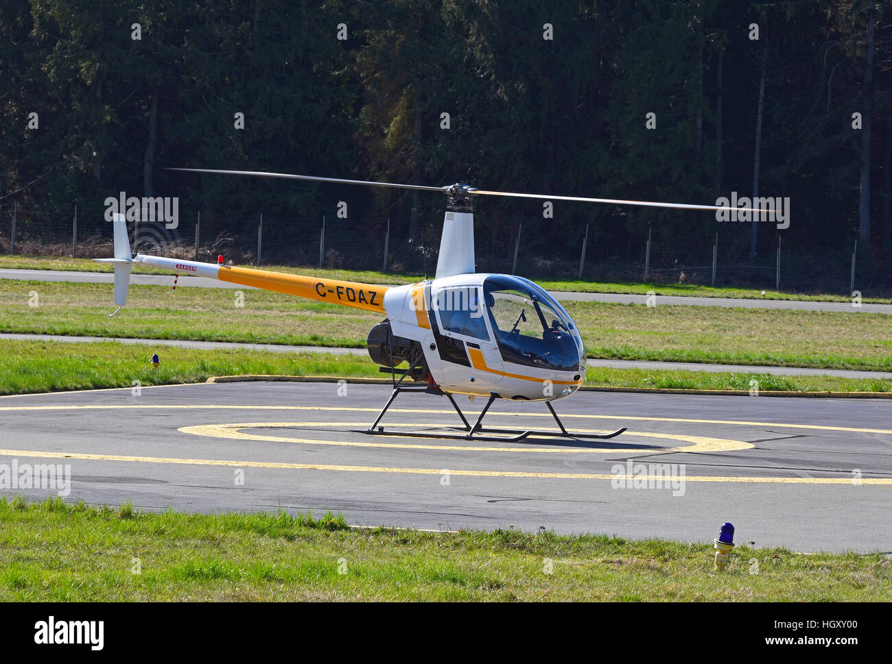 Robinson R22 (C-FDAZ) Light two seat helicopter at Qualicum airport on Vancouver island, BC. Canada.  SCO 11,607. - Stock Image