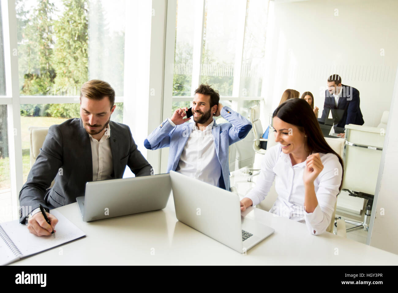 Young business people having meeting in modern office - Stock Image
