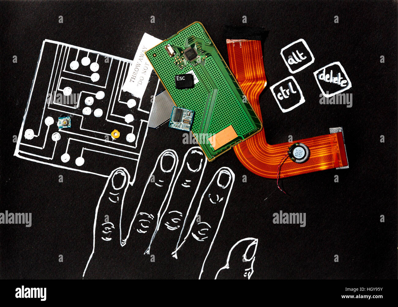 Computer circuit board and pieces laid on a drawing of an outline of a hand black background white outline - Stock Image