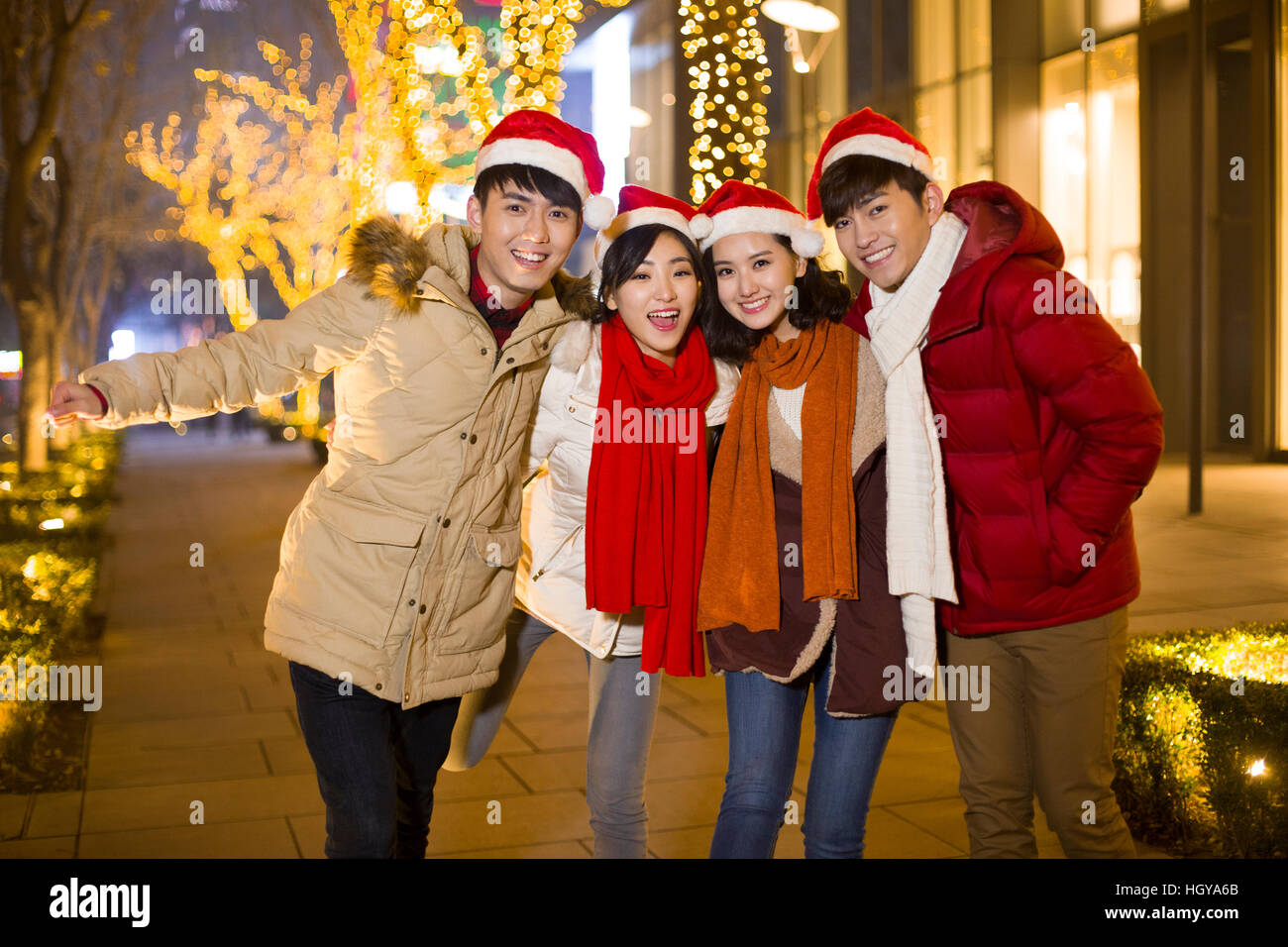 happy young friends celebrating christmas stock image