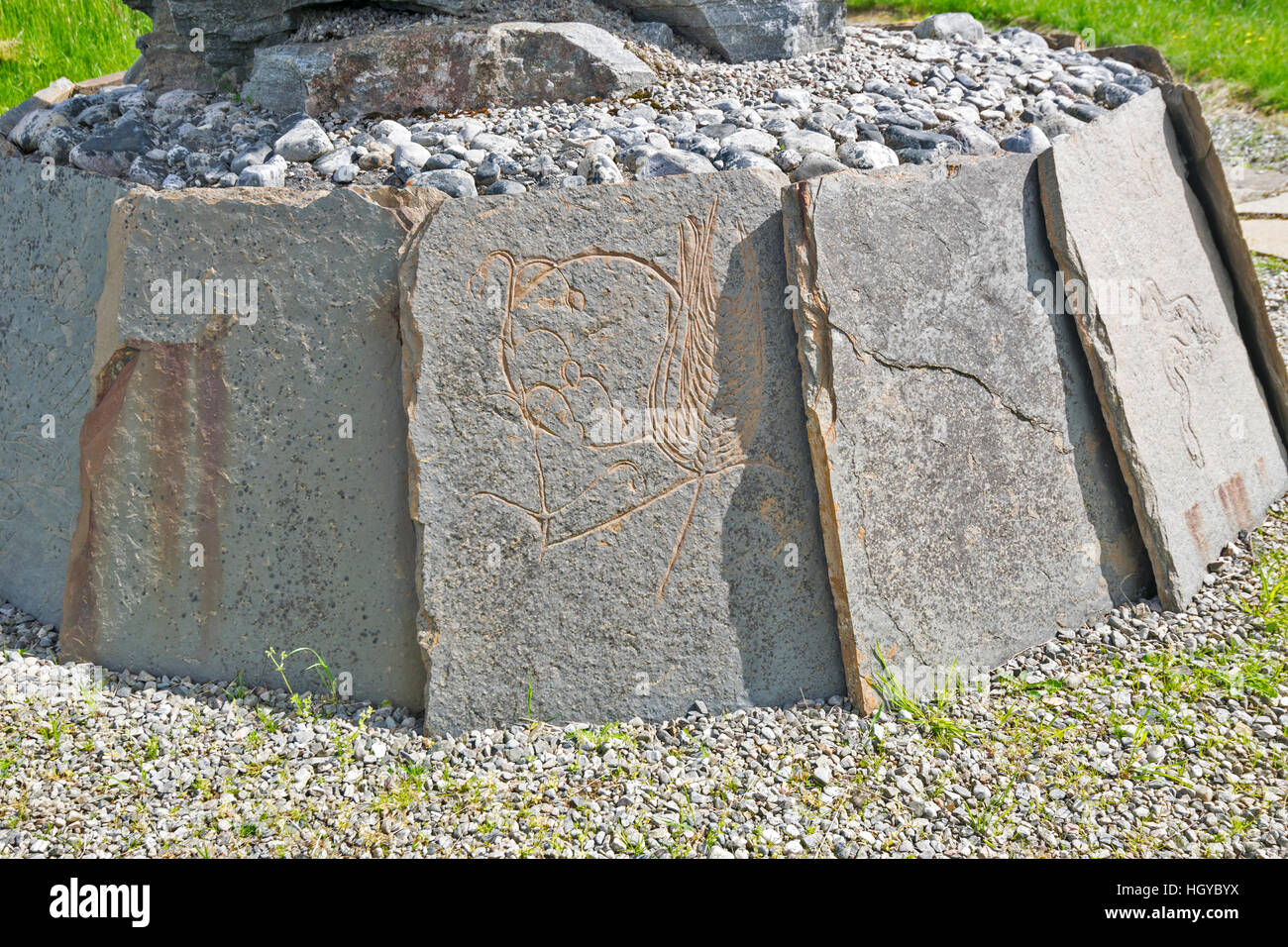 NEIL GUNN MEMORIAL STRATHPEFFER NEAR INVERNESS IN EARLY SUMMER CLOSE UP FLAGSTONES WITH CARVED PICTURES Stock Photo