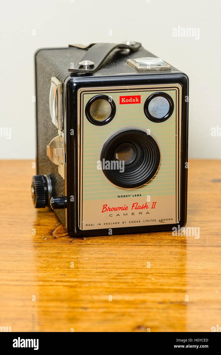 Classic Kodak Box Brownie camera on polished wood top - Stock Image
