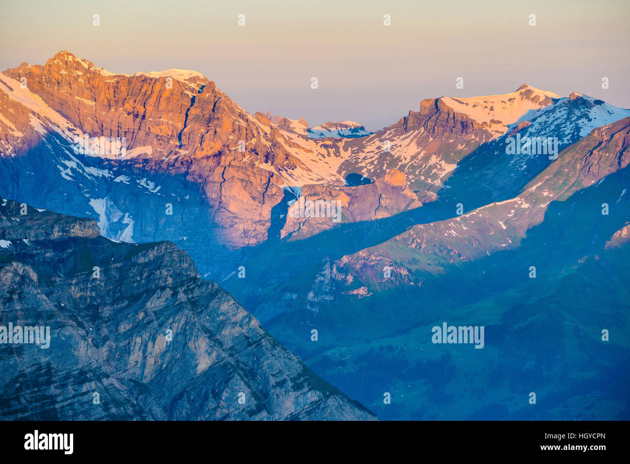 Morning light on the 3193m Büttlassen and 2929m Hundshorn in the Swiss Alps with the Lauterbrunnen valley in - Stock Image