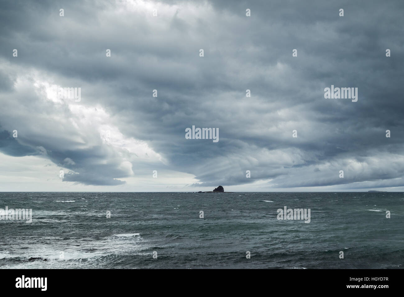 Dramatic and dark clouds above ocean on Jeju Island in South Korea. - Stock Image