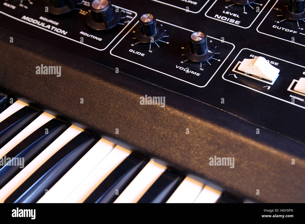 Closeup of keyboard and controls of a retro analogue synthesizer - Stock Image