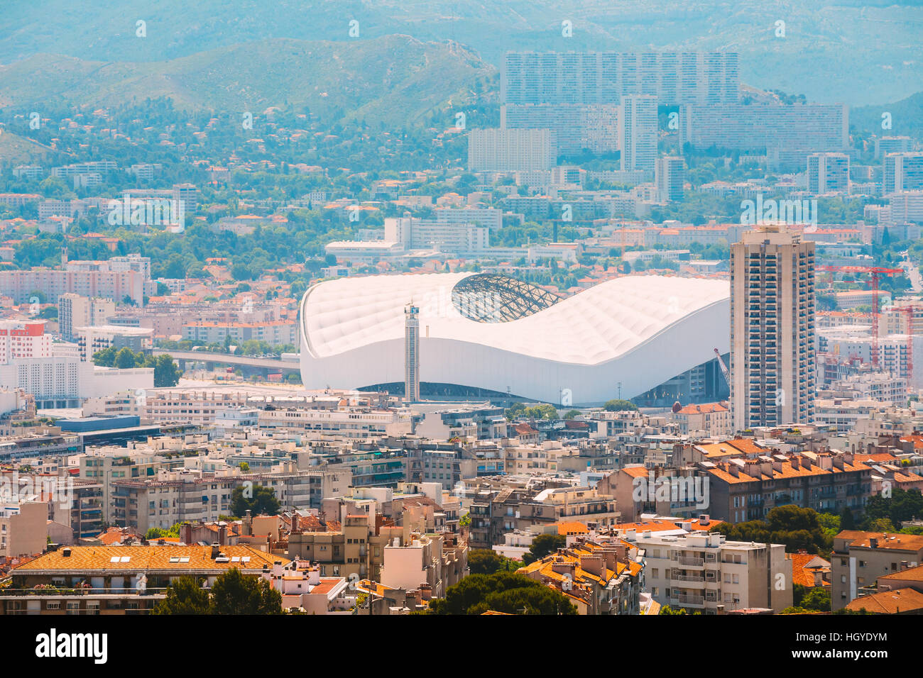 Cityscape of Marseille, France. Urban background with sport Velodrome stadium. Stade Velodrome. - Stock Image