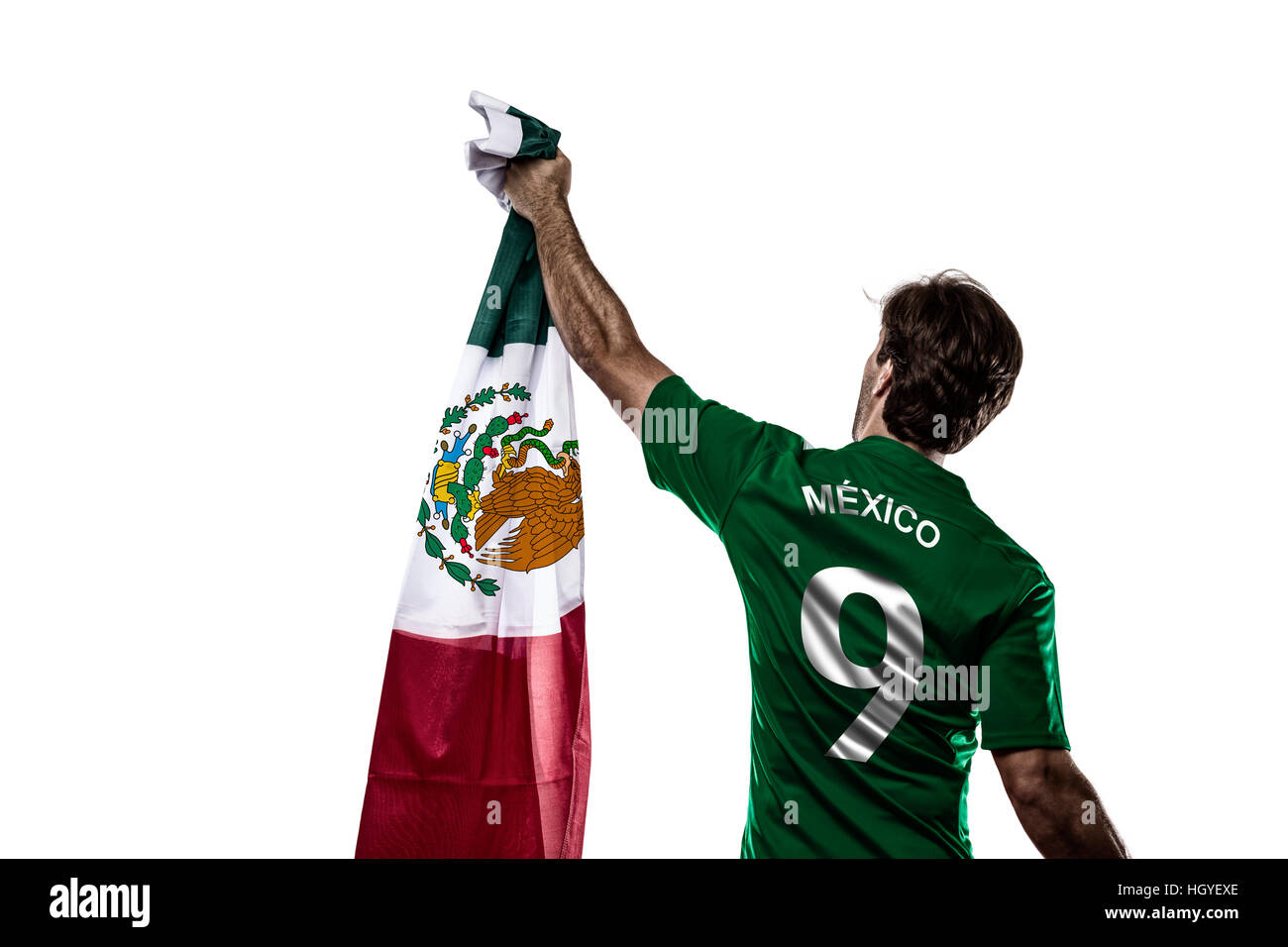 Mexican soccer player, celebrating on the white backgrond. - Stock Image