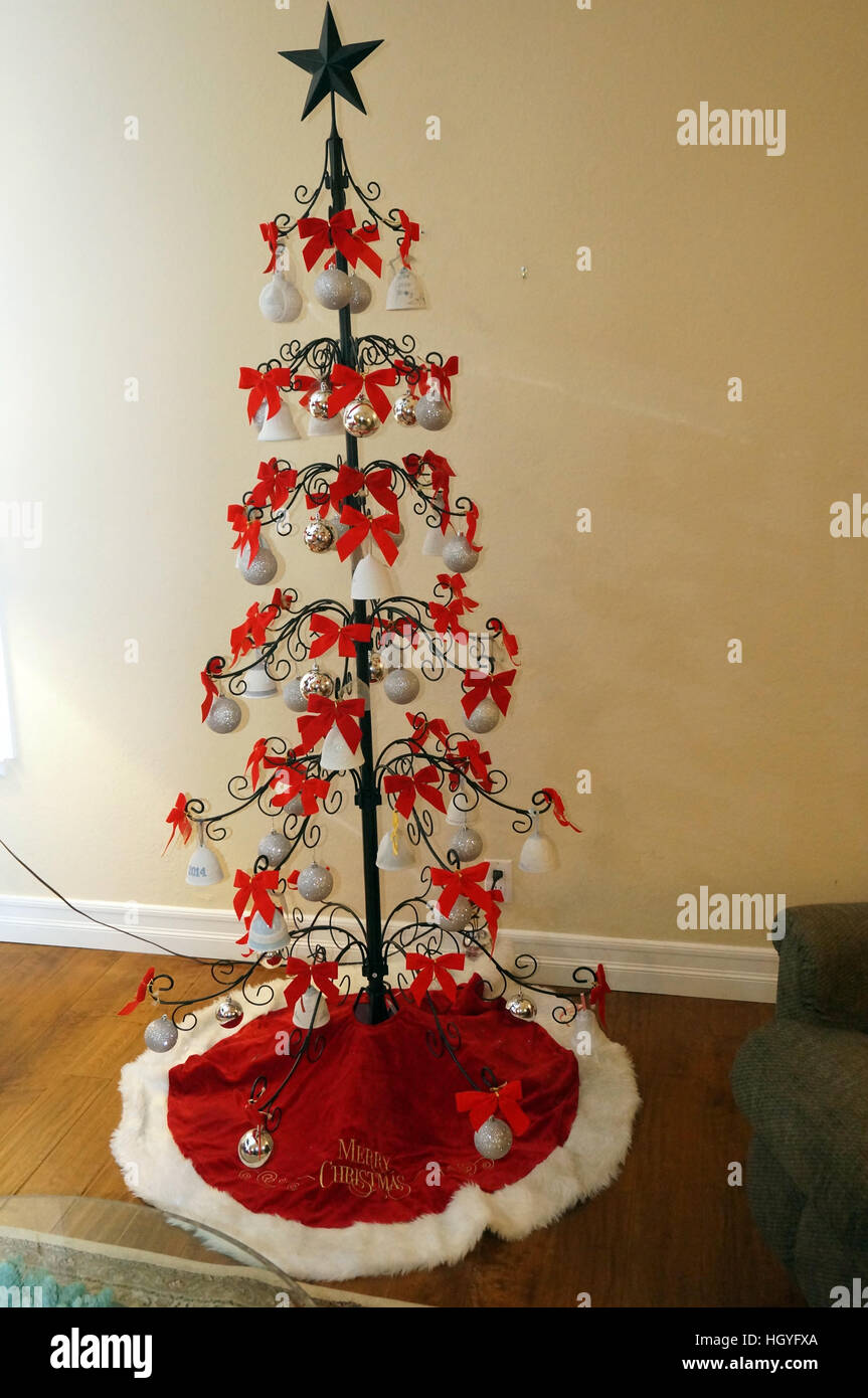 Ceramic Bell Christmas Tree with Red Bows - Stock Image