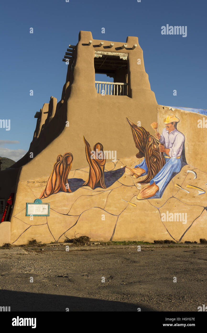 New Mexico, Taos, mural on adobe building - Stock Image