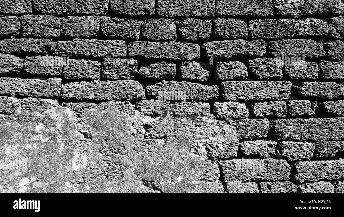 laterite stone material monochrome at temple in Sukhothai world heritage - Stock Image