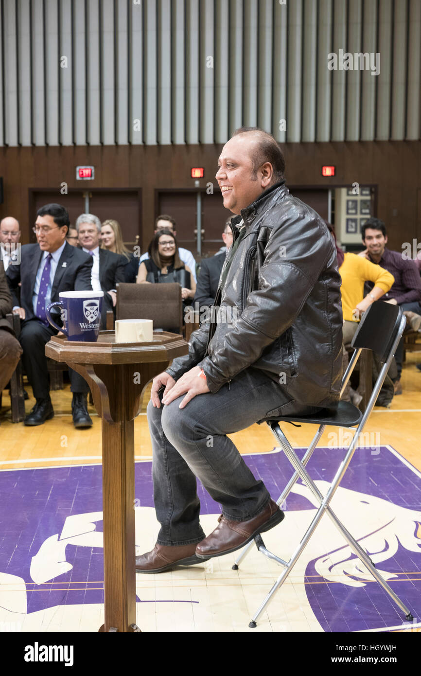 London, Ontario, Canada, 13th January, 2017. A member of the audience sits on the chair reserved for the Prime Minister - Stock Image