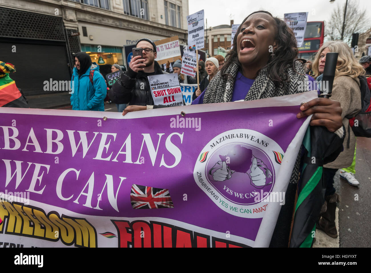 London, UK. 14th January 2017. Zimbabweans support the Movement for Justice march through Brixton communities against - Stock Image