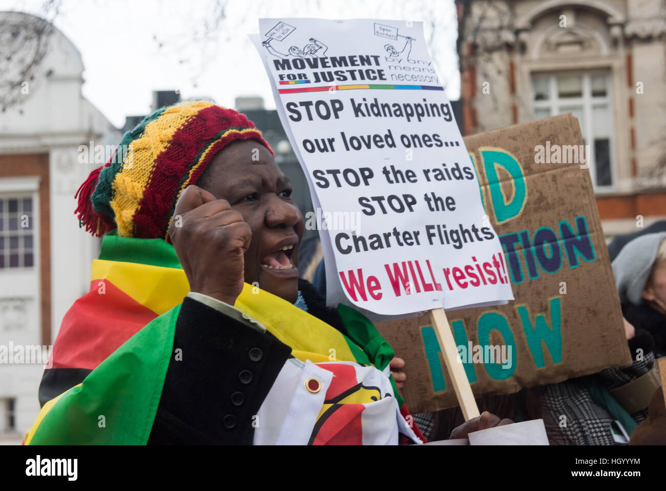 London, UK. 14th January 2017. A Zimbabwean woman at the rally at the end of the Movement for Justice march through - Stock Image