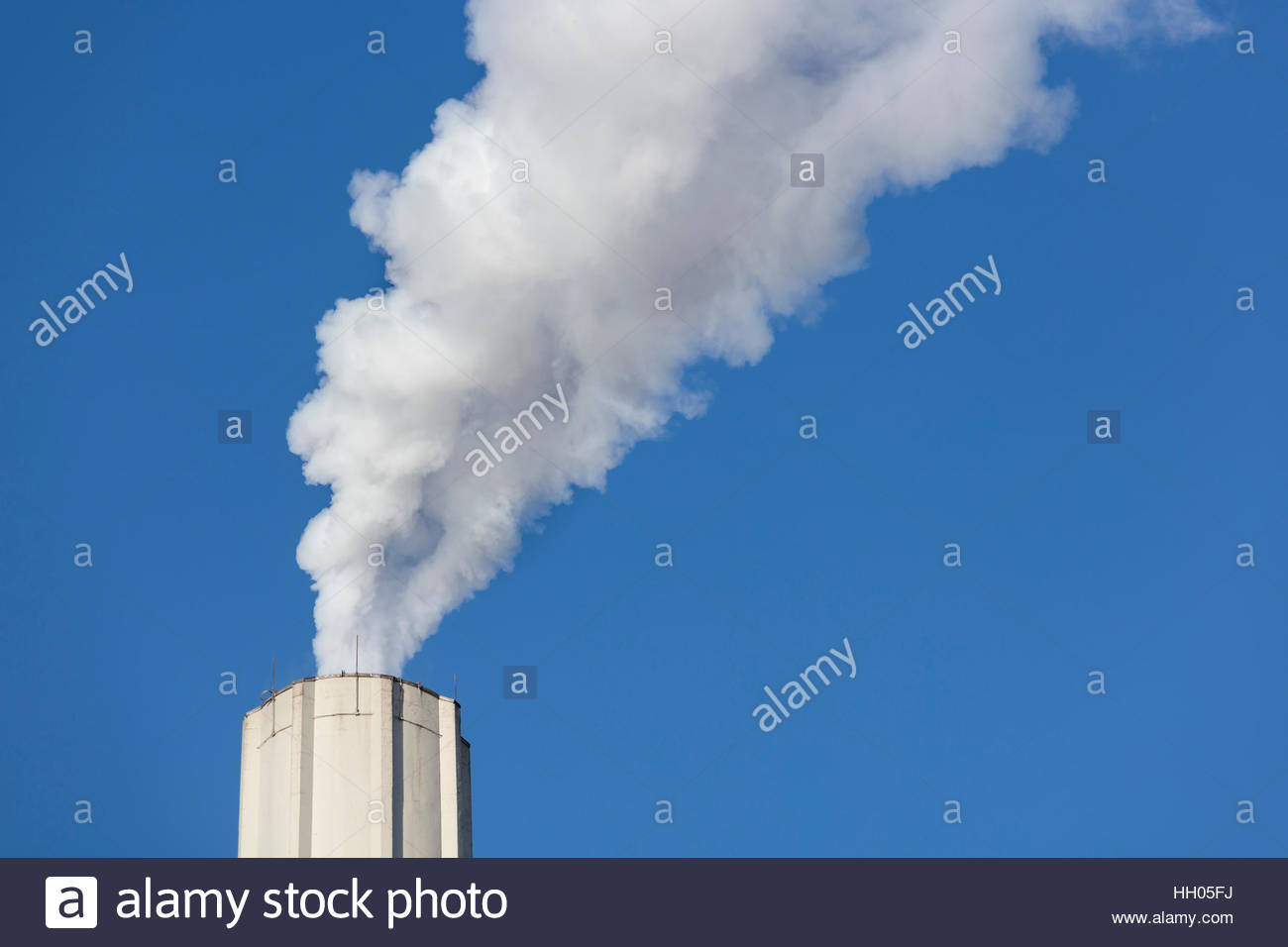 smoke chimney global warming climate change air pollution blue sky Ontario Canada. - Stock Image