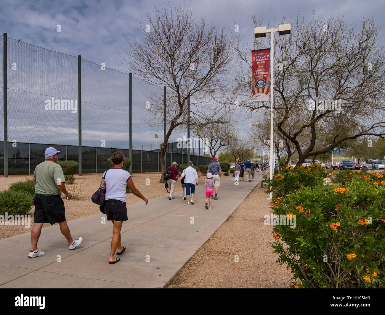 Fans walk to the entrance, of the Maryvale Baseball Park, Phoenix, Arizona. - Stock Image