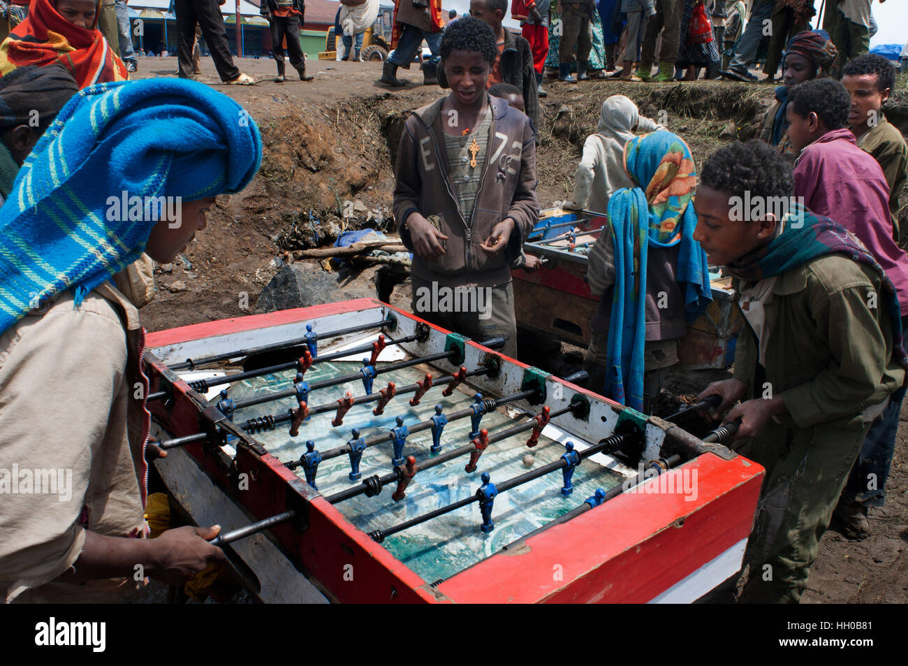 Market place. Debark. Simien Mountains. Northern Ethiopia. Debark Market. Several children play foosball while their - Stock Image