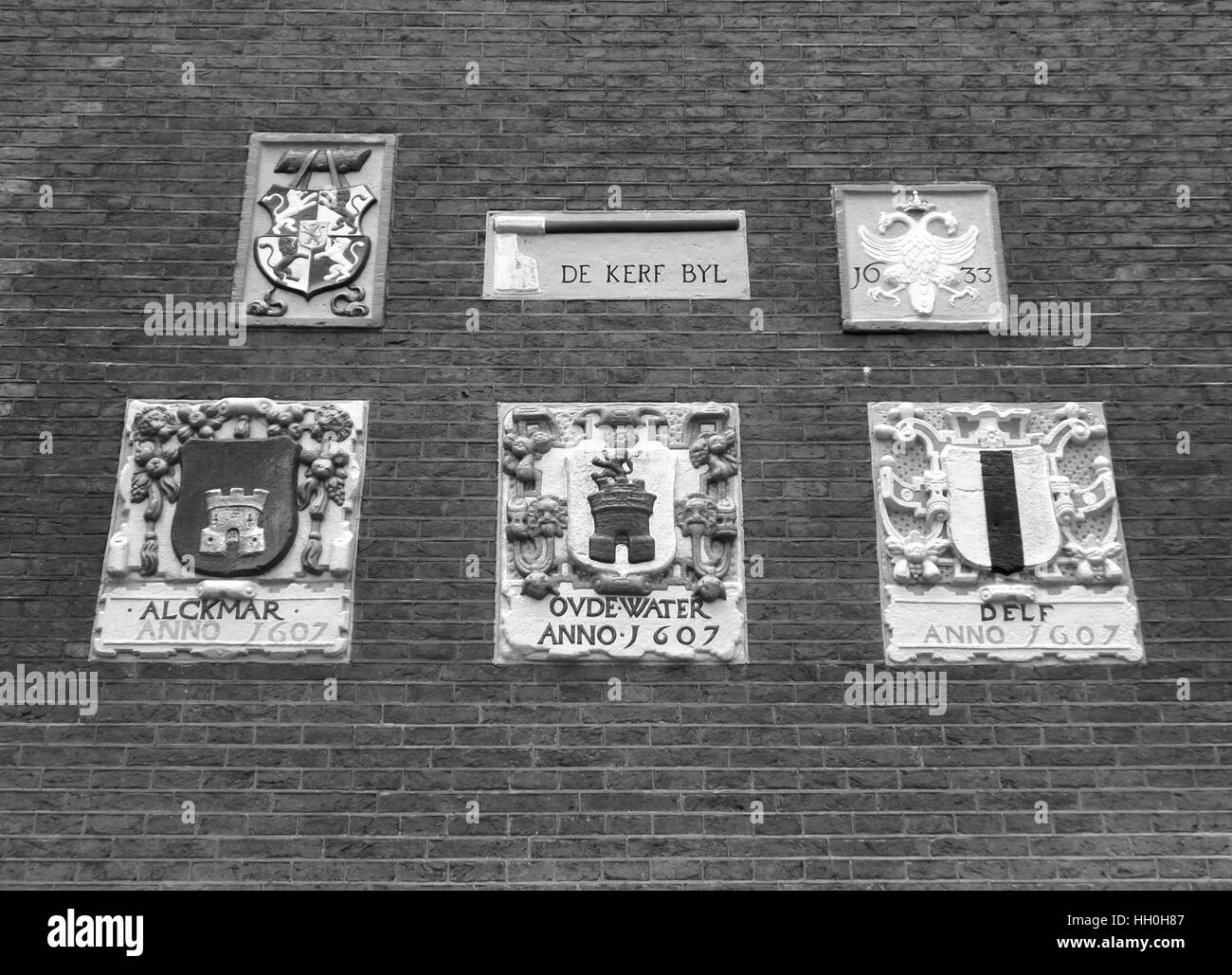 Monochrome photo of bricks wall with vintage style relief, Amsterdam, The Netherlands - Stock Image