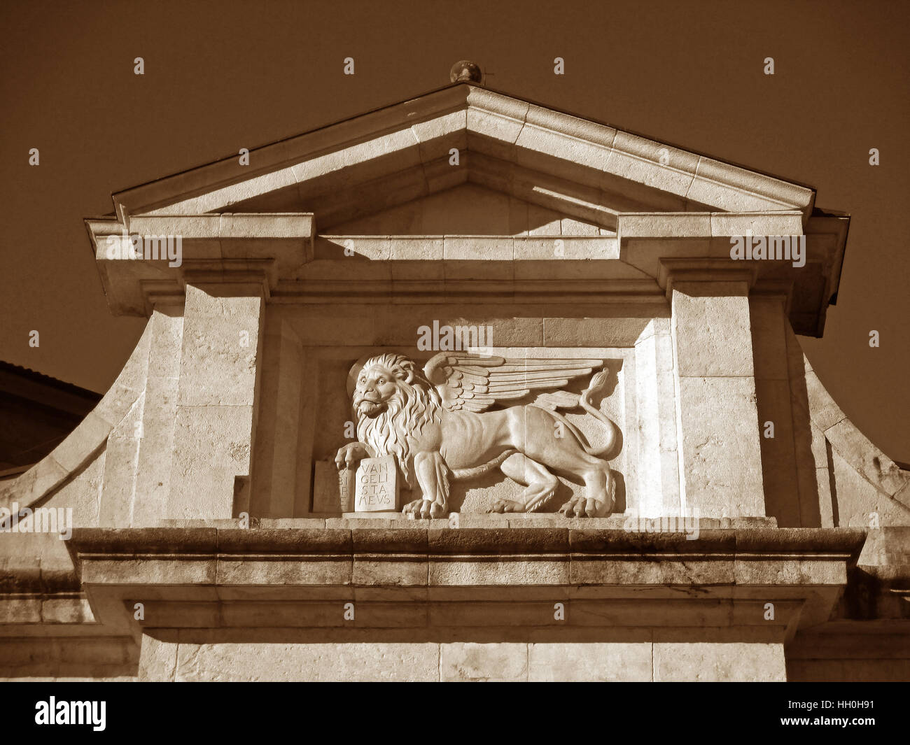 Beautiful Relief of Porta San Giacomo, City Gate of the Upper Town in Bergamo of Italy in Sepia Tone - Stock Image