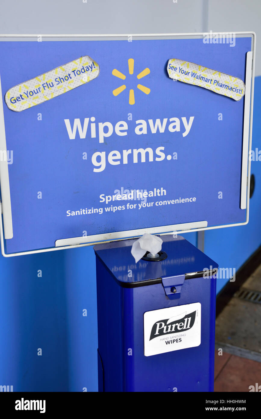 Disinfectant wipes for customer use on supermarket shopping cart handles, USA - Stock Image