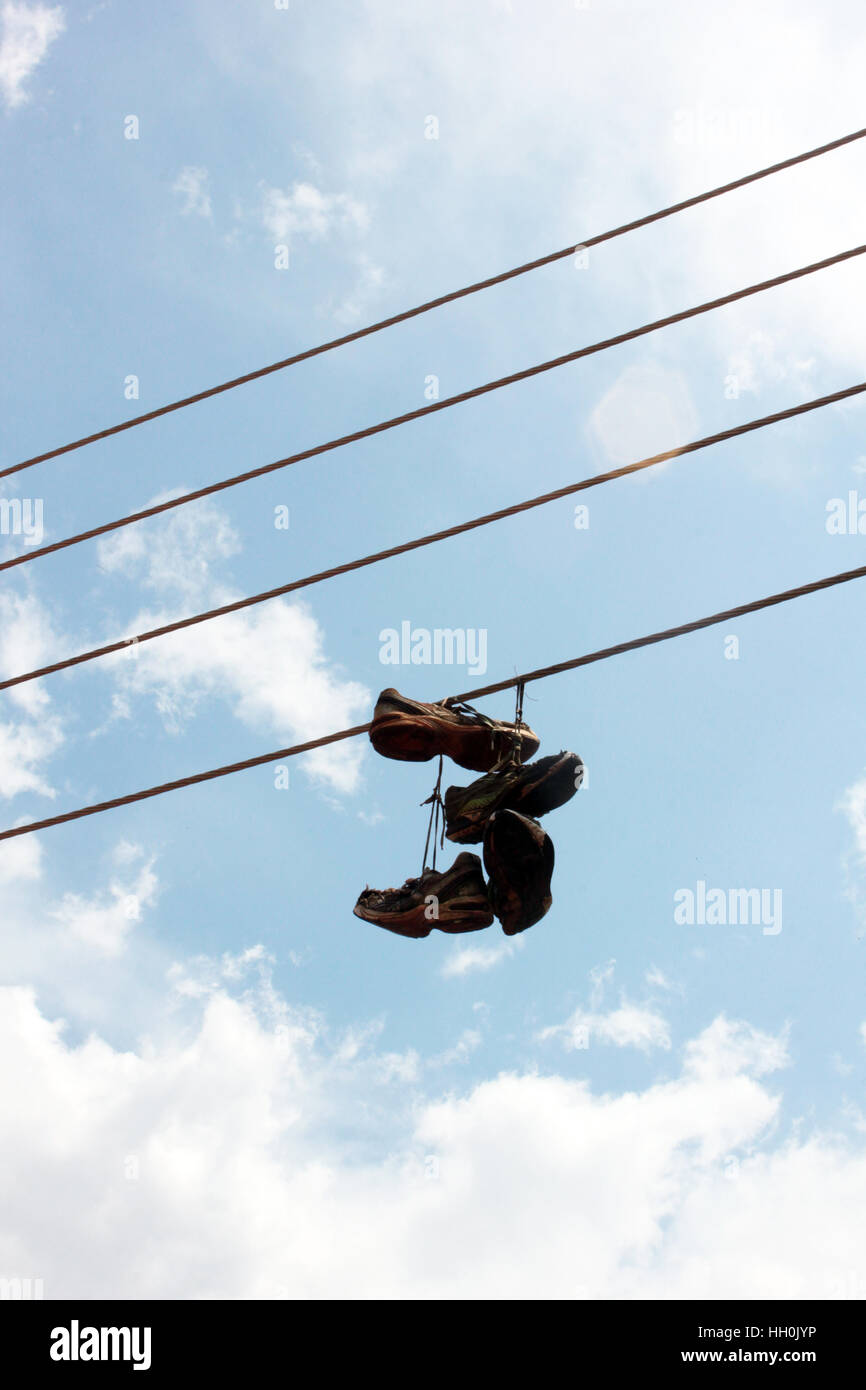 Boxing sneakers bungling near a boxing club in the suburb of the Ugandan capital city, Kampala. Stock Photo