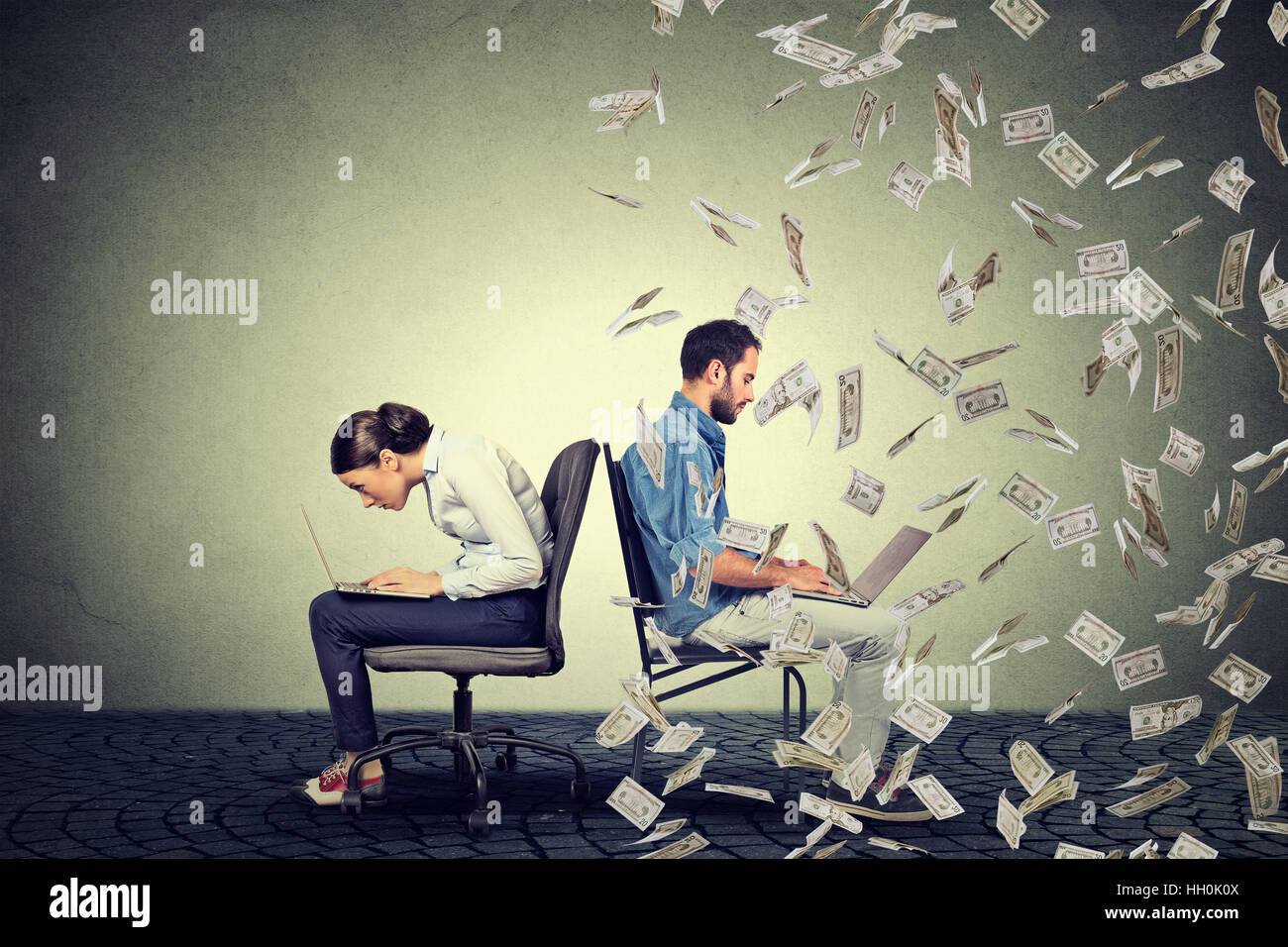Employee compensation economy concept. Woman working on laptop sitting next to young  man under money rain. Pay - Stock Image