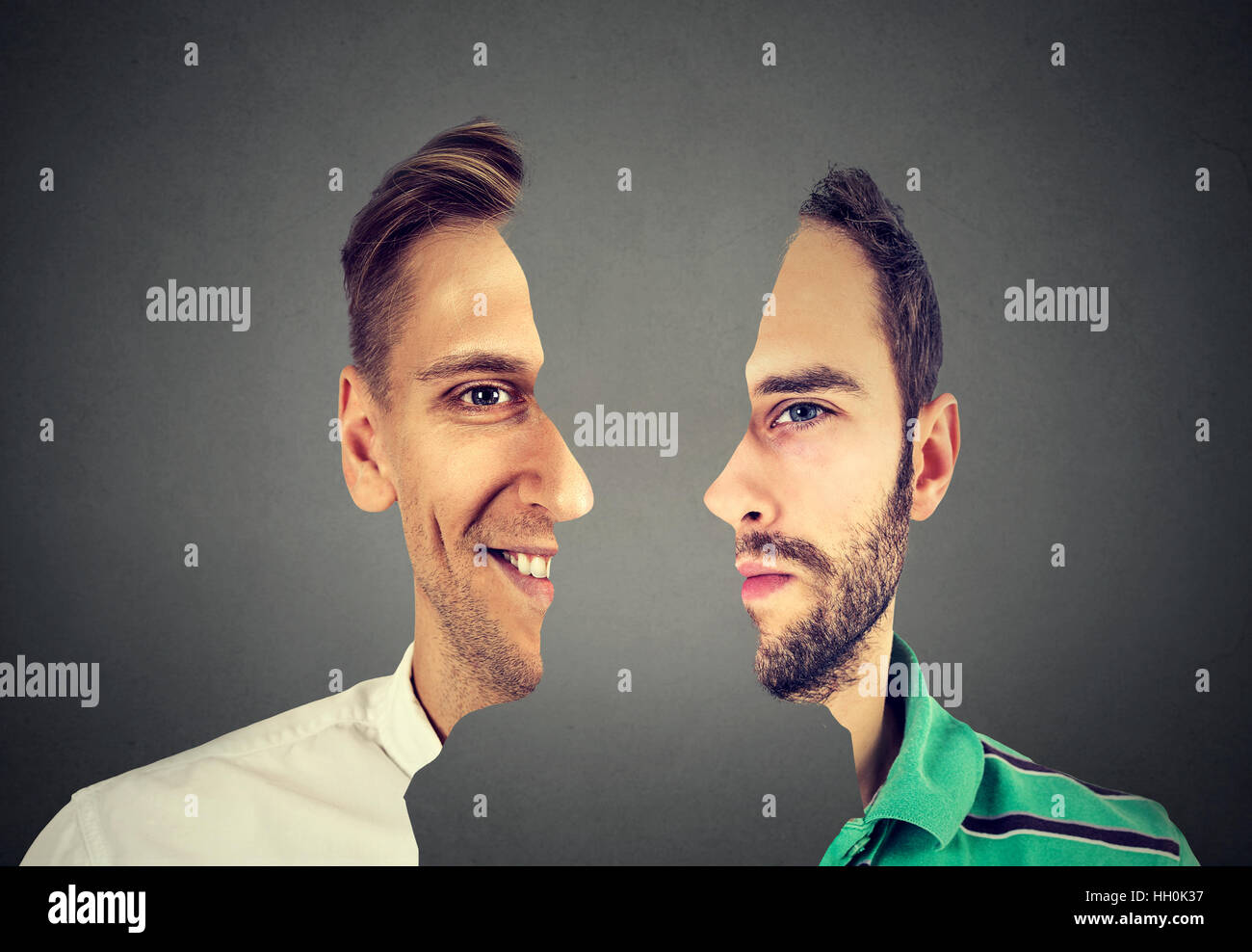 surrealistic portrait front with cut out profile of two young men isolated on gray wall background - Stock Image