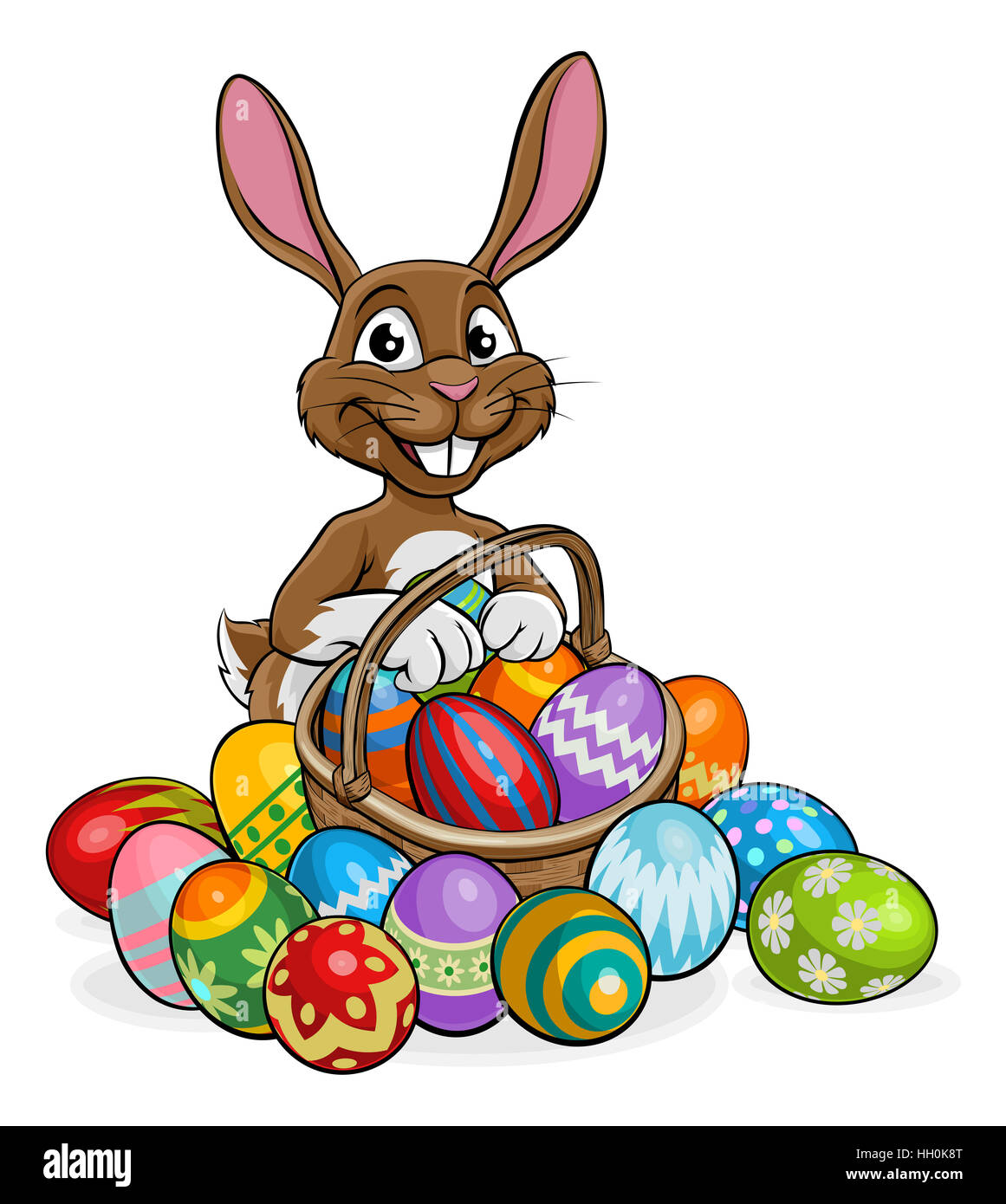cartoon bunny on an easter egg hunt with a basket or hamper stock photo  130936872