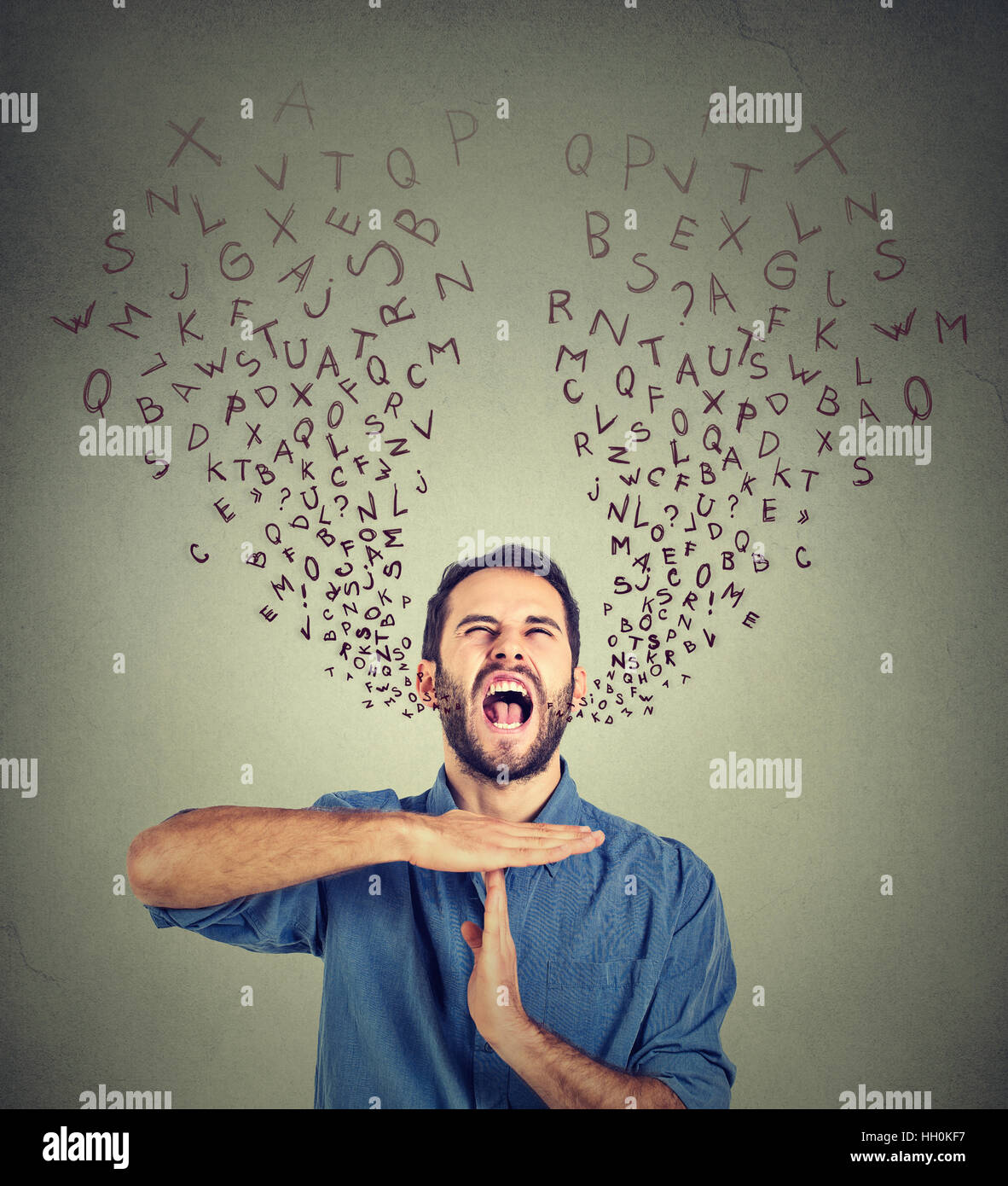 man showing time out gesture frustrated screaming alphabet letters coming out of mouth isolated gray background. - Stock Image