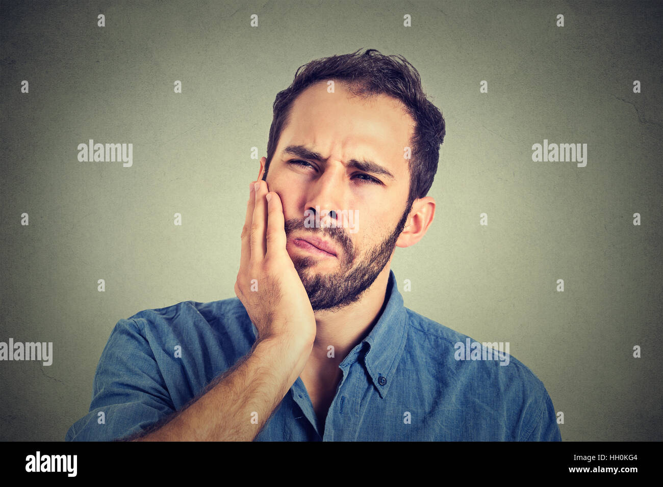young man with a toothache tooth pain - Stock Image