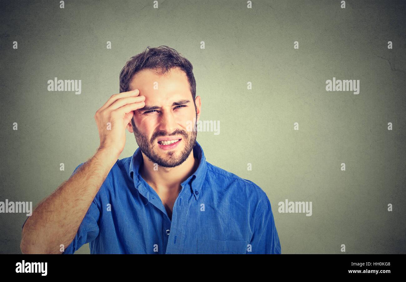 Man having headache - Stock Image