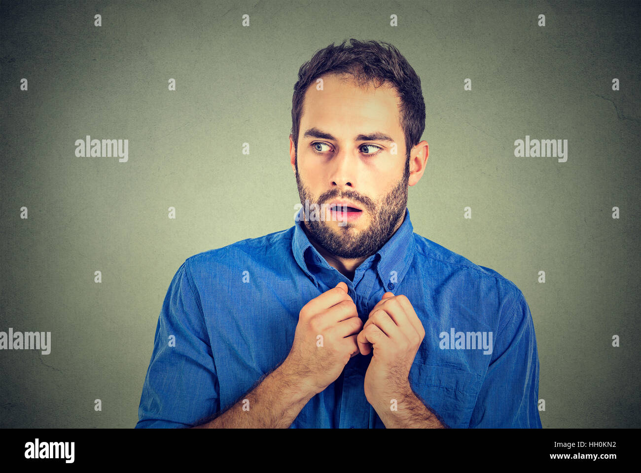portrait nervous stressed man feels awkward looking sideway anxiously craving something isolated gray background. - Stock Image