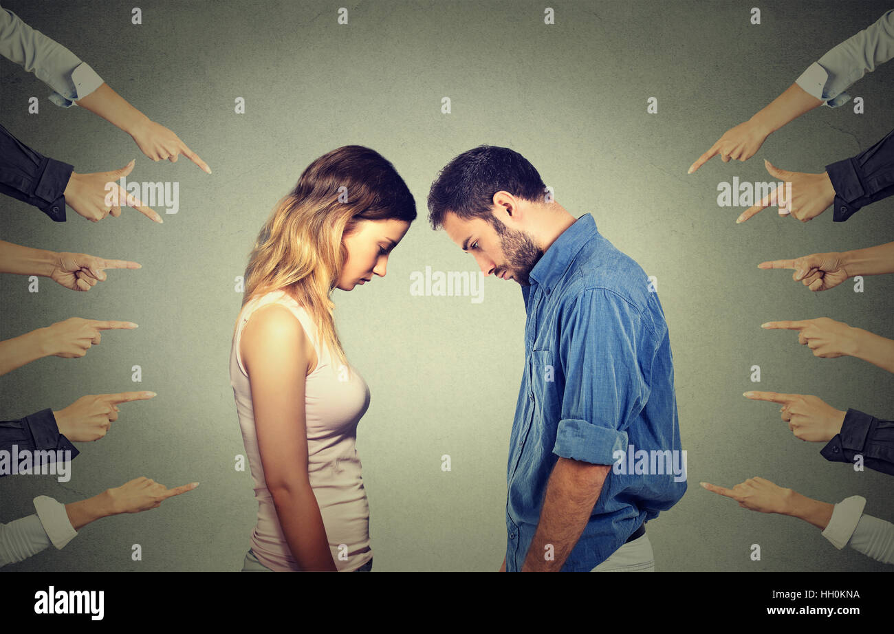 Marriage relationship difficulties . Accusation of guilty people. Sad woman and men looking down many fingers pointing - Stock Image