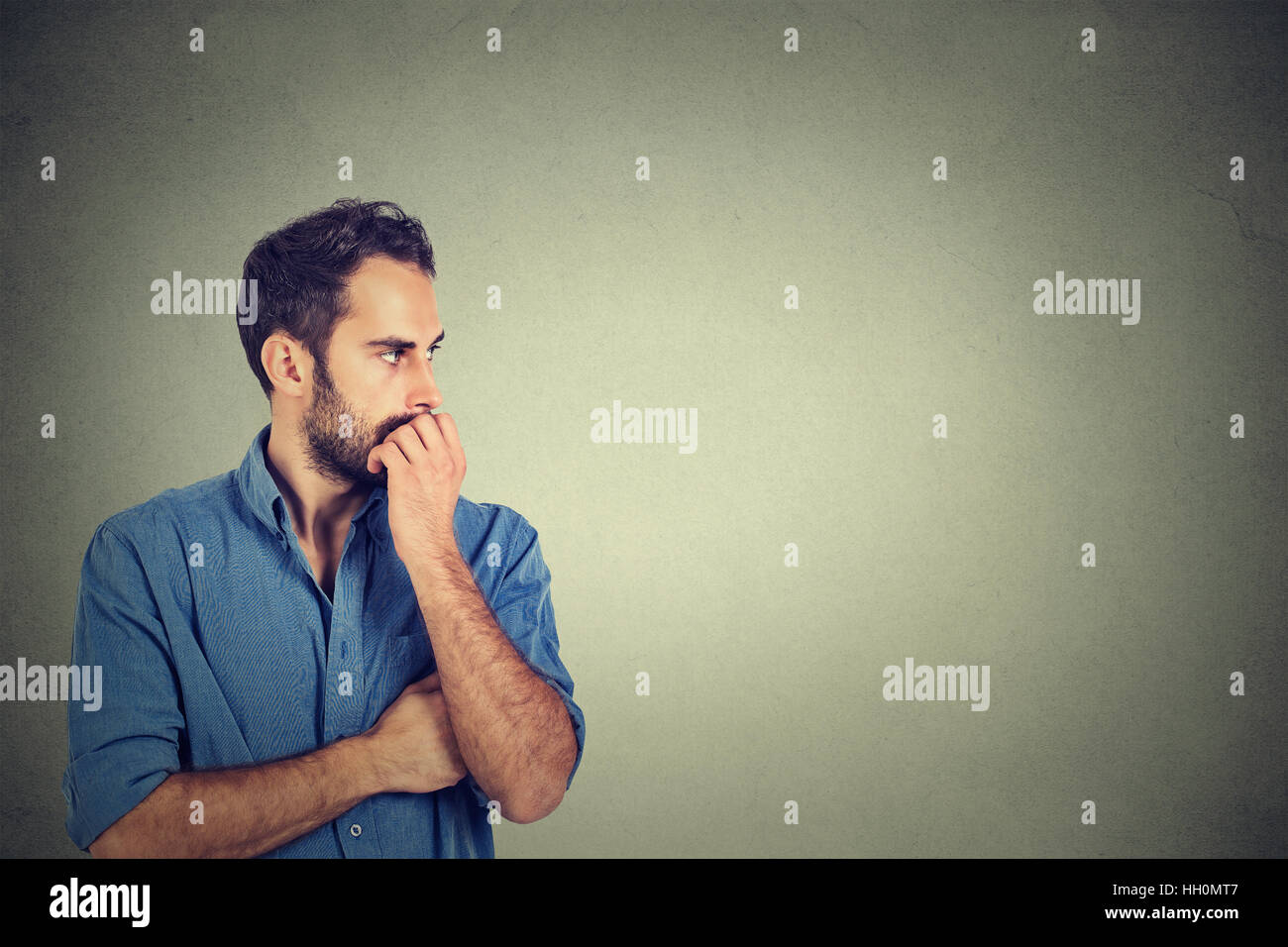 Preoccupied anxious young man - Stock Image