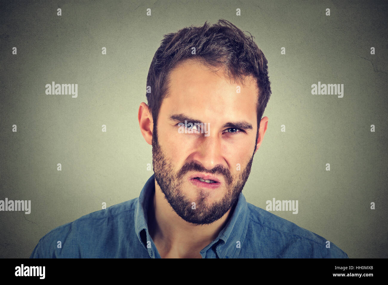 Annoyance. Angry displeased young man - Stock Image