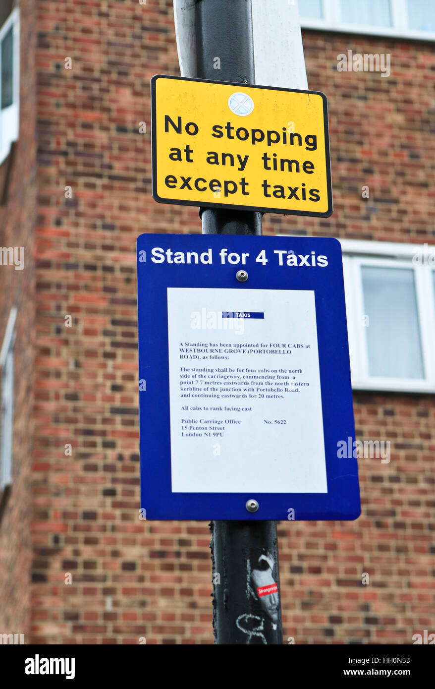 Street sign. Not stopping at any time except taxis. London. UK - Stock Image