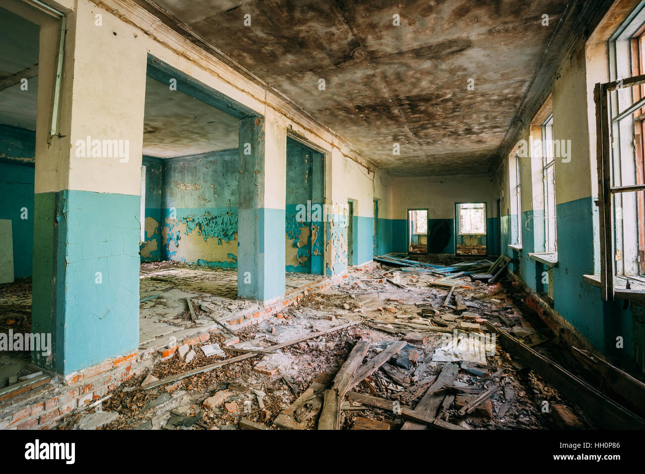 The Ruined Hall Of Abandoned Rural School After Chernobyl Disaster In Evacuation Zone. The Terrible Consequences Stock Photo